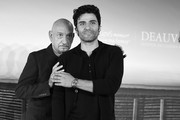 """This image has been converted to black and white).  Sir Ben Kingsley and Oscar Isaac attend a photocall for """"Operation Finale"""" on September 8, 2018 in Deauville, France."""
