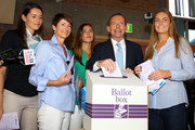Australian Opposition Leader, Tony Abbott casts his vote in the Federal Election, flanked by his daughters Bridget, Frances and Louise and his wife Margie on September 7, 2013 in Sydney, Australia. Polls predict a comfortable victory for the Abbott led conservative Liberal-National Party coalition against the incumbent Australian Labor Party.