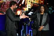 Bradley Cooper and Oprah Winfrey speak onstage during Oprah's SuperSoul Conversations at PlayStation Theater on February 05, 2019 in New York City.
