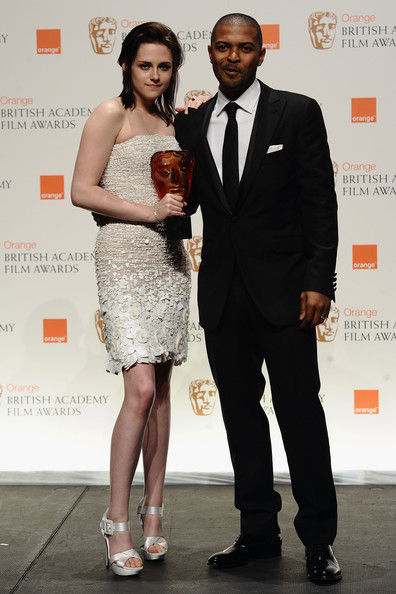Presenter Noel Clarke with Kristen Stewart as she celebrates winning the Orange Rising Star Award at the Orange British Academy Film Awards at the Royal Opera House on February 21, 2010 in London, England. The Orange Rising Star Award is the only award voted for by the public. XXXX was one of five international actors and actresses nominated whose talent has inspired popular acclaim from the British public.