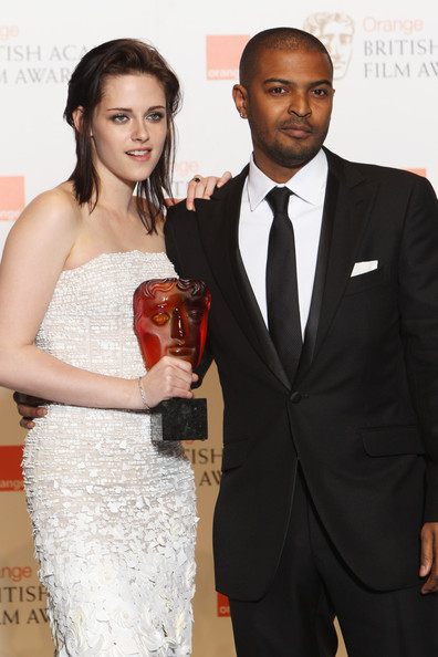 (UK TABLOID NEWSPAPERS OUT) Noel Clarke poses with Kristen Stewart after presentng her with the Orange rising star award in front of the winners boards at the Orange British Academy Film Awards held at The Royal Opera House on February 21, 2010 in London, England.