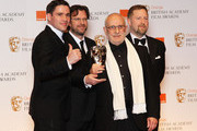Special Visual Effects award winners Tim Burke, John Richardson, Greg Butler, David Vickery pose in the press room during the Orange British Academy Film Awards 2012 at the Royal Opera House on February 12, 2012 in London, England.