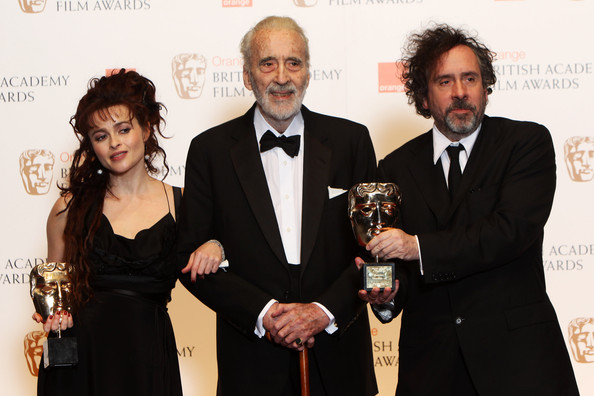 (UK TABLOID NEWSPAPERS OUT) Director Tim Burton and Helena Bonham Carter present Sir Christopher Lee with the Academy Fellowship in front of the winners boards at the Orange British Academy Film Awards 2011 held at The Royal Opera House on February 13, 2011 in London, England.