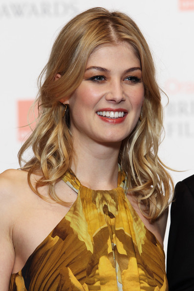 (UK TABLOID NEWSPAPERS OUT) Rosamund Pike poses in front of the winners boards at the Orange British Academy Film Awards 2011 held at The Royal Opera House on February 13, 2011 in London, England.