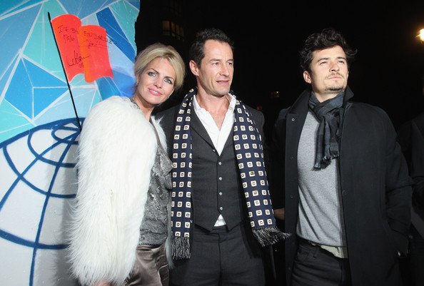 Orlando Bloom Actor Orlando Bloom (R), his cousin director Sebastian Copeland and Copeland's wife Caroline Doerwald stand next to a piece of the former Berlin Wall upon their arrival at the Cinema For Peace Green Evening 2010 at the China Club on November 12, 2010 in Berlin, Germany.