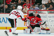 Cory Schneider #35 of the New Jersey Devils makes the third period save on Chris Neil #25 of the Ottawa Senators at the Prudential Center on January 21, 2016 in Newark, New Jersey. The Devils defeated the Senators 6-3.