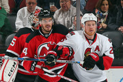 Eric Gelinas #44 of the New Jersey Devils and Chris Neil #25 of the Ottawa Senators jockey for position in the crease during the first period at the Prudential Center on January 21, 2016 in Newark, New Jersey.