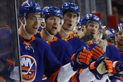 (l-r) Anders Lee #27, Josh Bailey #12, Brock Nelson #29 and Jason Chimera #25 of the New York Islanders celebrate a goal against the Ottawa Senators at the Barclays Center on December 1, 2017 in the Brooklyn borough of New York City. The Senators defeated the Islanders 6-5.