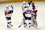 Craig Anderson #41 of the Ottawa Senators is congratualted by Bobby Ryan #6, Chris Neil #25, and Curtis Lazar #27 after they beat the San Jose Sharks at SAP Center on January 18, 2016 in San Jose, California.