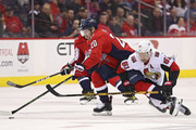 Lars Eller #20 of the Washington Capitals skates past Mark Stone #61 of the Ottawa Senators during the first period at Capital One Arena on February 27, 2018 in Washington, DC.