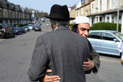 The Respect Party's George Galloway (L) greets a man during his election campaigning on April 24, 2015 in Bradford, England. Britain goes to the polls in a General Election on May 7.
