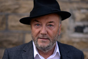 The Respect Party's George Galloway poses for a portrait during election campaigning on April 24, 2015 in Bradford, England.  Britain goes to the polls in a General Election on May 7.