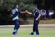 Phil DeFreitas of PCA England Masters is congratulated by team mate Dominic Cork after his catch during the PCA Summer Garden Party at The Hurlingham Club on July 19, 2018 in London, England.