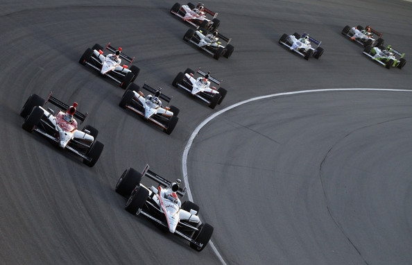 Ryan Briscoe, driver of the #6 Team Penske Dallara Honda,  leads Marco Andretti, driver of the #26 Team Venom Energy Andretti Autosport Dallara Honda, during the IndyCar Series PEAK Antifreeze and Motor Oil Indy 300 at Chicagoland Speedway on August 28, 2010 in Chicago, Illinois.