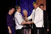 Director Shaun Monson accepts the River Phoenix Award from actor Joaquin Phoenix, Liberty Phoenix, Arlyn Phoenix and Jeffrey Weisberg onstage at PETA's 35th Anniversary Party at Hollywood Palladium on September 30, 2015 in Los Angeles, California.