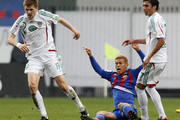 Keisuke Honda (C) of PFC CSKA Moscow in action against Oleg Ivanov and Facundo Piriz of FC Terek Grozny during the Russian Premier League match between PFC CSKA Moscow and FC Terek Grozny at the Arena Khimki Stadium on May 04, 2013 in Khimki, Russia.