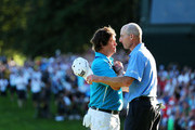 Jason Dufner of the United States is congratulated by playing partner Jim Furyk on the 18th green after his two-stroke victory at the 95th PGA Championship at Oak Hill Country Club on August 11, 2013 in Rochester, New York.