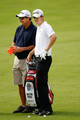 Justin Rose of England waits with his caddie Mark Fulcher during a practice round prior to the start of the 92nd PGA Championship on the Straits Course at Whistling Straits on August 11, 2010 in Kohler, Wisconsin.