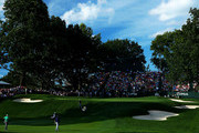 Tiger Woods, Keegan Bradley and Davis Love III of the United States walk to the 18th green during the second round of the 95th PGA Championship on August 9, 2013 in Rochester, New York.