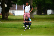 James Wright of Market Drayton Golf Club and Andrew MacCullum (a) of Market Drayton Golf Club line up a putt on the 16th green during the PGA National Pro-Am Qualifiers - Midland at Little Aston Golf Club on June 7, 2016 in Sutton Coldfield, England.