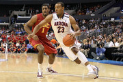 Derrick Williams #23 of the Arizona Wildcats drives on Alex Stepheson #1 of the USC Trojans in the first half in the semifinals of the 2011 Pacific Life Pac-10 Men's Basketball Tournament at Staples Center on March 11, 2011 in Los Angeles, California.