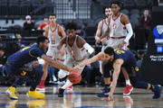 (L-R) Marcus Lee #24 of the California Golden Bears, Daejon Davis #1 of the Stanford Cardinal and Nick Hamilton #21 of the Golden Bears go after a loose ball during a first-round game of the Pac-12 basketball tournament at T-Mobile Arena on March 7, 2018 in Las Vegas, Nevada. The Cardinal won 76-58.