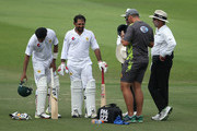 Sarfraz Ahmed of Pakistan receives treatment after being struck  by a short delivery during day three of the Second Test match between Australia and Pakistan at Sheikh Zayed stadium on October 18, 2018 in Abu Dhabi, United Arab Emirates.