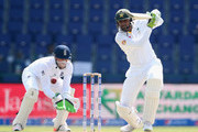 Shoaib Malik of Pakistan bats during Day One of the First Test between Pakistan and England at Zayed Cricket Stadium on October 13, 2015 in Abu Dhabi, United Arab Emirates.