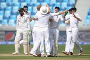 Ben Stokes of England celebrates with teammates after dismissing Shoaib Malik of Pakistan during the 2nd test match between Pakistan and England at Dubai Cricket Stadium on October 22, 2015 in Dubai, United Arab Emirates.