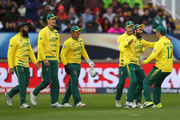 Imran Tahir (2R) of South Africa celebrates taking a catch off the bowling of Morne Morkel to dismiss Mohammad Hafeez of Pakistan during the ICC Champions Trophy match between Pakistan and South Africa at Edgbaston on June 7, 2017 in Birmingham, England.