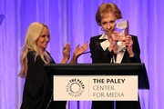 Kristin Chenoweth (L) and Carol Burnett appear on stage at The Paley Honors: A Special Tribute To Television's Comedy Legends at the Beverly Wilshire Four Seasons Hotel on November 21, 2019 in Beverly Hills, California.