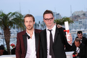 Actor Ryan Gosling (R) and 2011 Best Director Nicolas Winding Refn of the film 'Drive' pose at the Palme d'Or Winners Photocall at the Palais des Festivals during the 64th Cannes Film Festival on May 22, 2011 in Cannes, France.