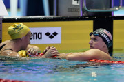 Katie Ledecky (R) of the United States is congratulated after winning the gold medal by Ariarne Titmus of Australia after competing in the Women's Freestyle 800m Timed-Final on day one of the Pan Pacific Swimming Championships at Tokyo Tatsumi International Swimming Center on August 9, 2018 in Tokyo, Japan.