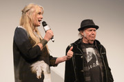 """Director Daryl Hannah and Neil Young attend the """"Paradox"""" red carpet premiere at Paramount Theatre during SXSW 2018 on March 15, 2018 in Austin, Texas."""