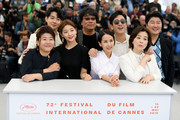 """Front Row: Lee Jung-Eun, Park So-dam, Cho Yeo-jeong and Chang Hyae-Jin, Back Row: Choi Woo-shik, Bong Joon-Ho, Lee Sun-gyun and Song Kang-ho attend thephotocall for """"Parasite"""" during the 72nd annual Cannes Film Festival on May 22, 2019 in Cannes, France."""
