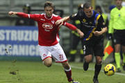Djamel Mesbah (R) of Parma FC competes for the ball with Andrea Barberis (L) of AS Varese during the Tim Cup match between Parma FC and AS Varese at Stadio Ennio Tardini on December 3, 2013 in Parma, Italy.