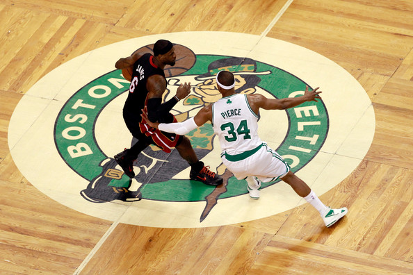 LeBron James #6 of the Miami Heat brings the ball up court against Paul Pierce #34