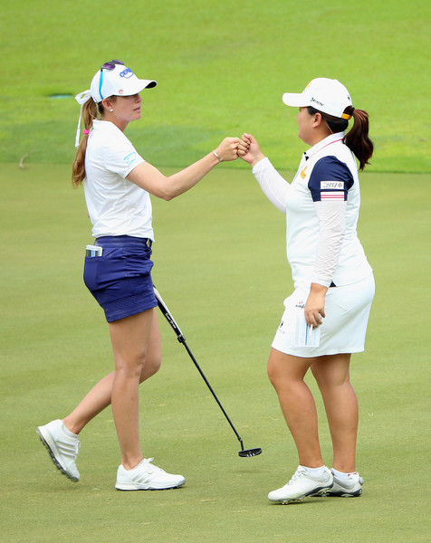 HSBC Women's Champions - Day One [day one,sports equipment,golfer,sport venue,golf,golf equipment,professional golfer,golf club,lady,recreation,sports,fists,paula creamer,inbee park,hole,united states,singapore,south korea,hsbc womens champions,round]