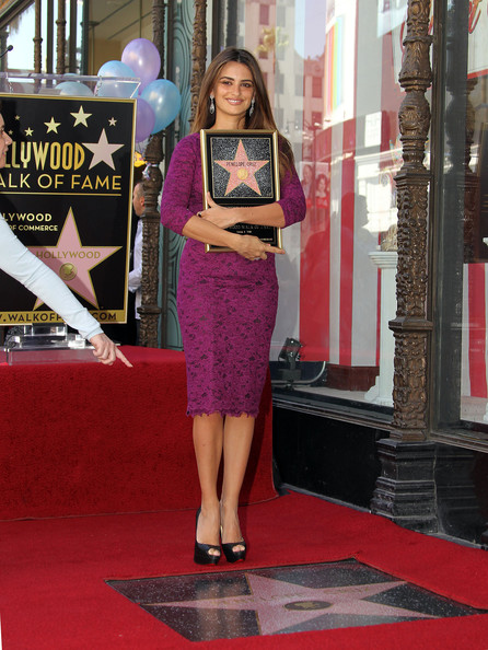 Actress Penelope Cruz poses for photographers during the installation ceremony for her star on the Hollywood Walk of Fame on April 1, 2011 in Hollywood, California.