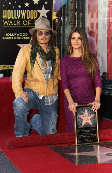Actor Johnny Depp (L) and actress Penelope Cruz pose for photographers during the installation ceremony for her star on the Hollywood Walk of Fame on April 1, 2011 in Hollywood, California.