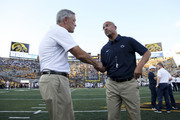 IOWA CITY, IOWA- SEPTEMBER 23:  Head coach James Franklin of the Penn State Nittany Lions visits with head coach Kirk Ferentz of the Iowa Hawkeyes before their match-up on September 23, 2017 at Kinnick Stadium in Iowa City, Iowa.