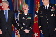 (L-R) Army Secretary John McHugh, Chief Warrant Officer Five Debra Blankenbaker and Army Chief of Staff General Raymond Odierno share a laugh during the commencement ceremony for the U.S. Army's annual observance of Sexual Assault Awareness and Prevention Month in the Pentagon Center Courtyard March 31, 2015 in Arlington, Virginia. Blankenbaker was presented with the Department of Defense Sexual Assault Prevention Innovation Award for her work with the 7th Civil Support Command. In conjunction with the national campaign against sexual assault, The Army announced this year's theme, 'Not in My Squad. Not in Our Army. We are Trusted Professionals,' during the ceremony.