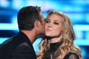 Actor Taylor Kinney (L) accepts the award for Favorite Dramatic TV Actor from actress Natalie Dormer onstage during the People's Choice Awards 2016 at Microsoft Theater on January 6, 2016 in Los Angeles, California.
