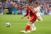 Christian Eriksen of Denmark is challenged by Yoshimar Yotun of Peru during the 2018 FIFA World Cup Russia group C match between Peru and Denmark at Mordovia Arena on June 16, 2018 in Saransk, Russia.