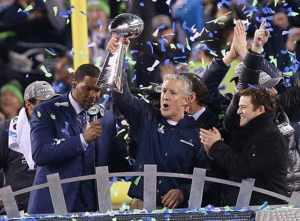 Head coach Pete Carroll of the Seattle Seahawks celebrates with the Vince Lombardi Trophy after their 43-8 victory over the Denver Broncos during Super Bowl XLVIII at MetLife Stadium on February 2, 2014 in East Rutherford, New Jersey.