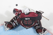 Scott Smith #35 of the Peterborough Petes stops a shot in the warm-up prior to playing against the London Knights in an OHL game at Budweiser Gardens on December 14, 2014 in London, Ontario, Canada.