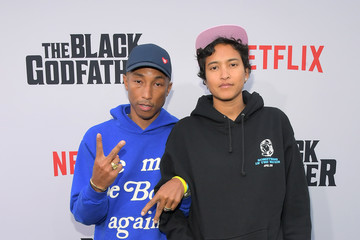 Pharrell Williams Helen Lasichanh Netflix World Premiere Of 'The Black Godfather'