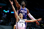 Joel Embiid #21 of the Philadelphia 76ers blocks a shot from Jeremy Lin #7 of the Brooklyn Nets in the second half during their Pre Season game at Nassau Veterans Coliseum on October 11, 2017 in Uniondale, New York.  User expressly acknowledges and agrees that, by downloading and or using this photograph, User is consenting to the terms and conditions of the Getty Images License Agreement.