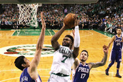 Jaylen Brown #7 of the Boston Celtics takes a shot against Ersan Ilyasova #23 of the Philadelphia 76ers and JJ Redick #17 during Game Five of the Eastern Conference Second Round of the 2018 NBA Playoffs at TD Garden on May 9, 2018 in Boston, Massachusetts. The Celtics defeat the 76ers 114-112 to advance to the Eastern Conference Finals.