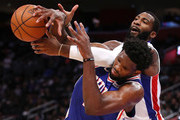 Andre Drummond #0 of the Detroit Pistons battles for the ball with Joel Embiid #21 of the Philadelphia 76ers during the second half at Little Caesars Arena on October 23, 2018 in Detroit, Michigan. Detroit won the game 133-132 in overtime. NOTE TO USER: User expressly acknowledges and agrees that, by downloading and or using this photograph, User is consenting to the terms and conditions of the Getty Images License Agreement.